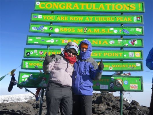 We did it! Donna and I standing on top of Kilimanjaro, summiting together at 08h45 on Friday, 13 July 2012 ~ What a great moment!