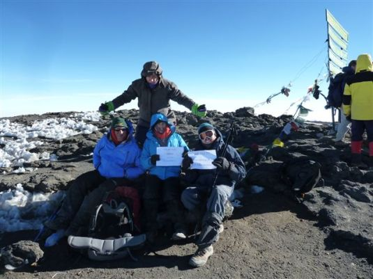 Sadly we missed this pic with Judi's signs. We were still on our way to the summit at this time. ~ Photo by Judi Kurgan