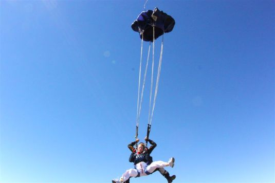 Our parachute opening ~ there really is nothing lady like about skydiving!!