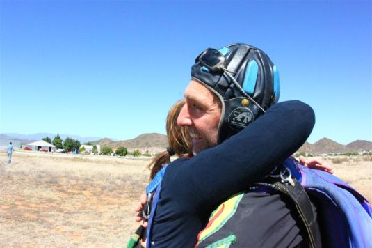 A hug for Timmy, my tandem master, who let me fly and got my safely back to earth and helped me tick off # 46 on my bucket list. Super-Amazing!!