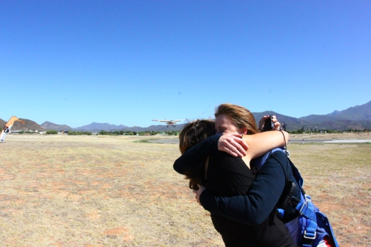Friends waiting on the other side of the runway with hugs as the plane that took me up lands behind us.