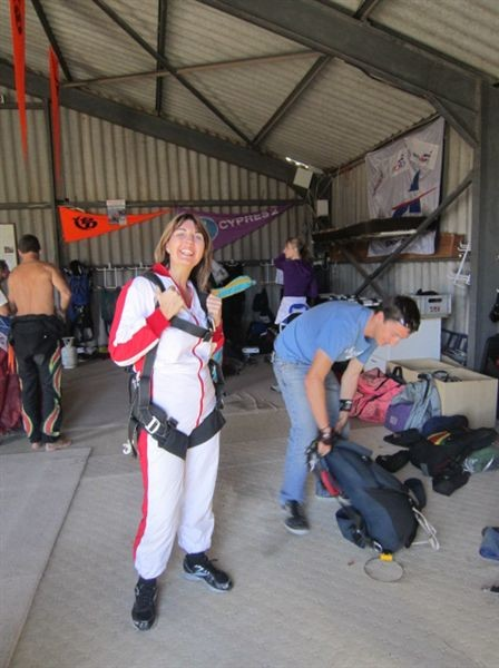 Natalie all suited up and ready to go. Mikey her tandem master behind her getting the parachute ready.