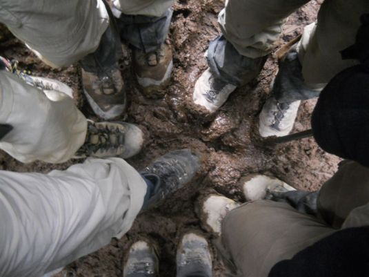 Our hiking boots caked in mud. We hadn't showered in 7 days and now it looked the part too!