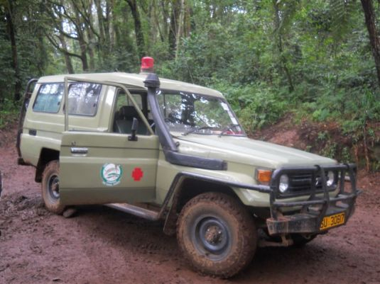 Leaving the muddy trail where the gravel road met up with it we found the real ambulance waiting for the patient to be brought down the mountain.