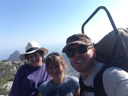 Three Kilimanjaro team members, back on the mountain and back in the full swing to train for the next of the Seven Summits. The picture with a view behind us.