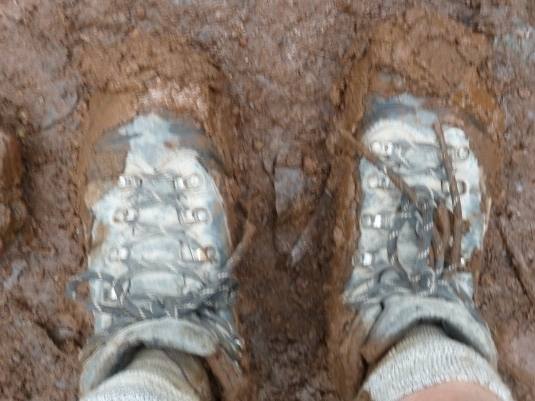 Judi's boots caked in mud, just like ours were! Photo by Judi Kurgan