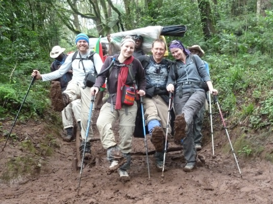 Muddy and dirty but still full of smiles ~ who cared what we looked like we just summited Kilimanjaro! Photo by Judi Kurgan
