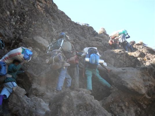 The porters, always carrying up incredible loads even up the great, vertical Barranco Wall!