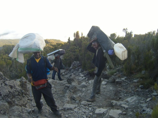 Porters making their way back down to our last camp on the mountain. Photo by Donna McTaggart