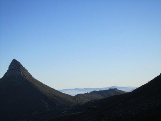 Views of Lions Head, Signal Hill and the sea beyond still partly shaded in the early morning.