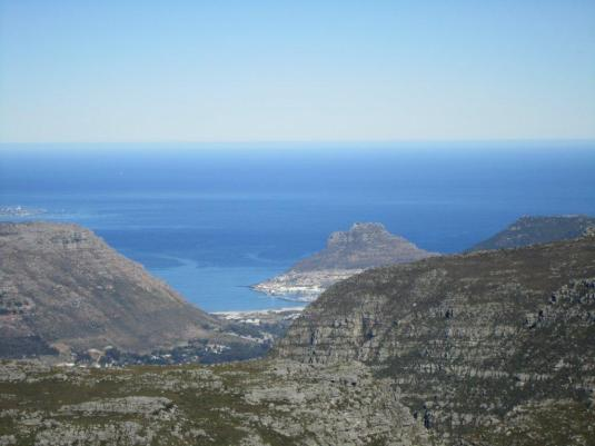 A view of Hout Bay and The Sentinal through the mountain peaks we climbed.