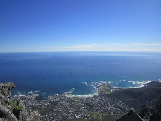Views of Camps Bay and the Atlantic Seaboard from the top of the mountain by the Upper Cable Way.