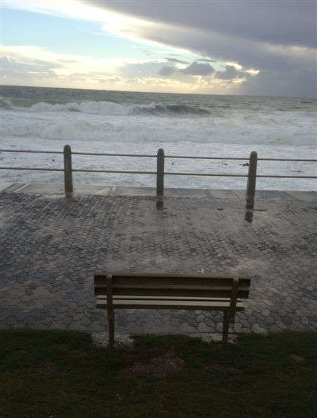 A lone bench overlooking the Atlantic Ocean. No one brave enough to sit for a while and watch.