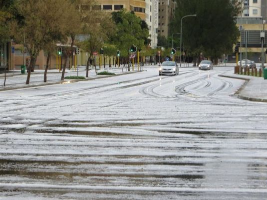 Driving on the roads right after the never before seen hail storm in Cape Town city centre. Photo by unknown person.