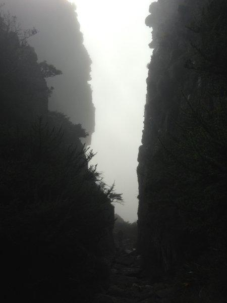Looking back between the sheer mountain walls that surrounding us all we could see was mist.