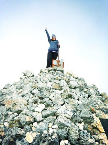 Me celebrating reaching the highest point of the mountain after ascending via Platteklip!