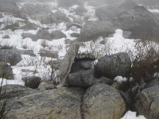 In snow and mist everything looks different but luckily carefully places cairns helped us find our way to the summit.