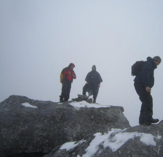 Bruce, Andre and Simon standing on top. I decided to give this rock jumping to the very top a miss and stayed on solid, snow covered ground. At least I hope it was solid!