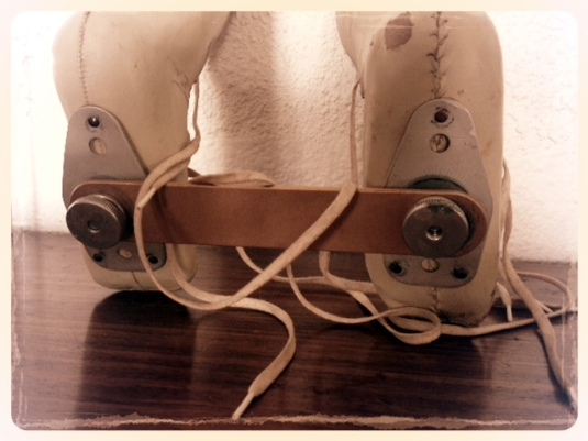 The Denis Browne splint had a steel rod attached to the sole of each boot connecting the two boots together, each with a dial to twist and tighten the boots in order to manipulate the babies legs.