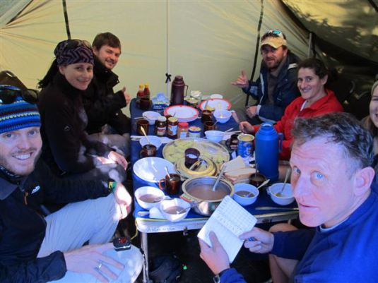 Here's a little flash back to our team about to enjoy breakfast one morning on Kilimanjaro.