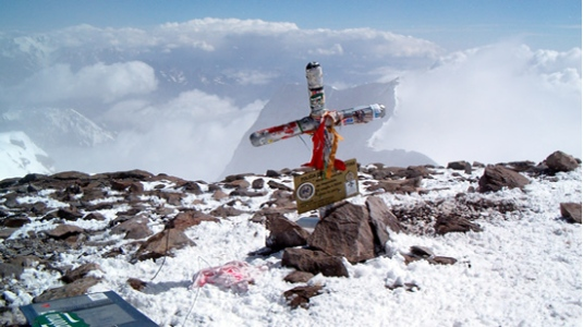 The cross on the summit of Aconcagua.  Pic from www.nogutsknowglory.com