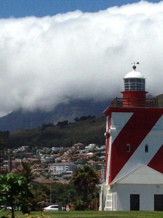 Behind the Mouille Point light house Devil's Peak is completely shrouded in cloud.