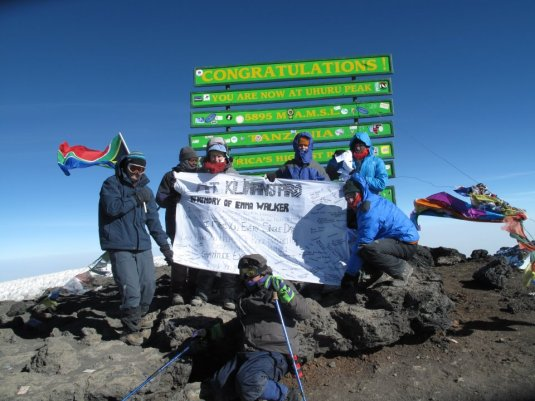 The team with my banner at the summit.