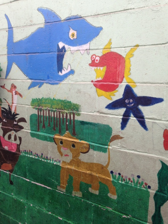 The simple, yet colourful murals on the walls of the recreation room.