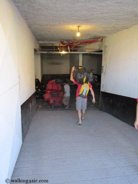 Moving our duffel bags down into the basement of our overnight stop.
