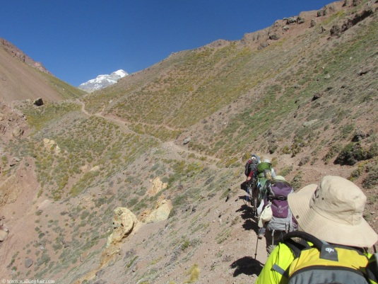 The team making their way up the very steep slope.