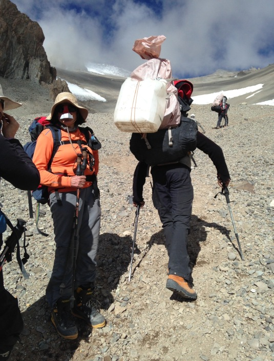 Letting the porters pass us by with their heavy loads. *Photo By Simon Bates*