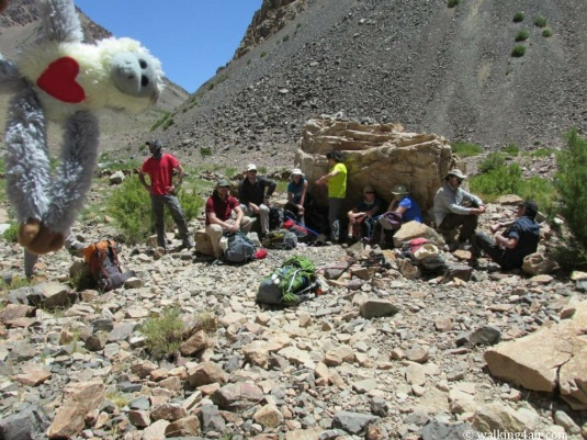 The team, and Perky our mascot, some trying to find shade against a rock, enjoying a lunch break.