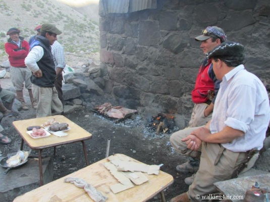 "The muleteers in the ""kitchen"" preparing our dinner."